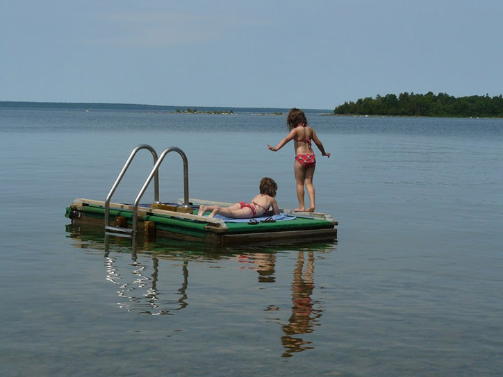 playing on raft at Fox Den Beach